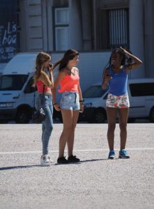 Three girls in shorts. Are they church clothes?