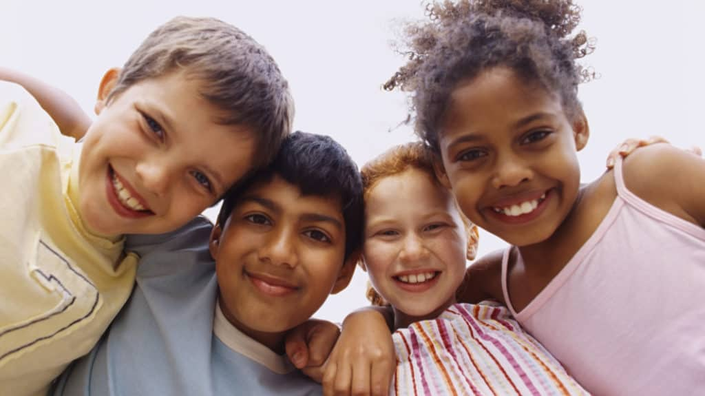 Four children of different skin color