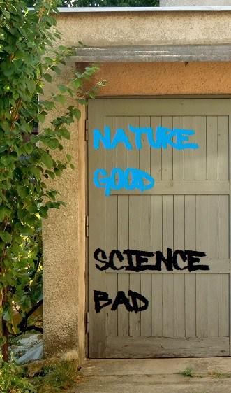 Graffiti on backyard door. NATURE GOOD. SCIENCE BAD