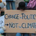Placard. Change Politics not Climate
